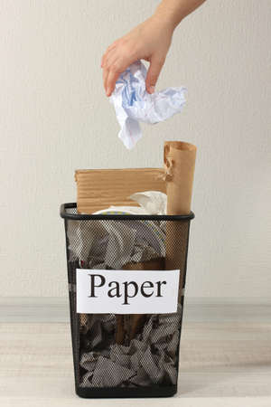 Assorted trash in bucket  photo