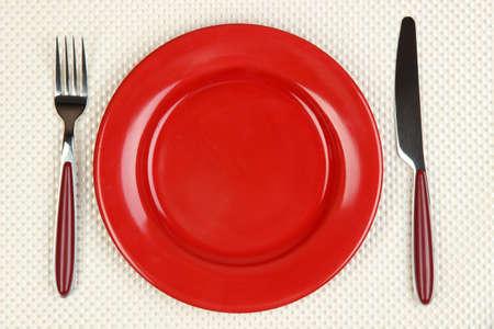 ナイフ、カラー プレートとフォーク 写真素材