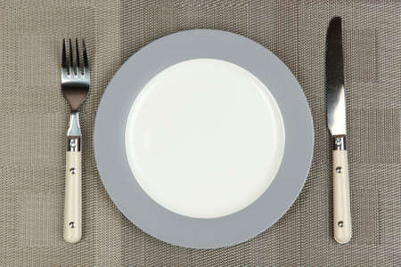 Knife, color plate and fork Stock Photo - 22672410