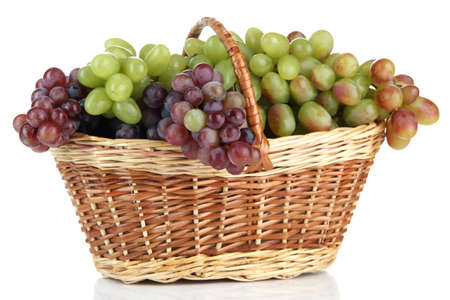 Fresh grape in wicker basket, isolated on white photo