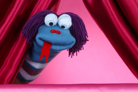 sock puppet: Puppet show on pink background Stock Photo