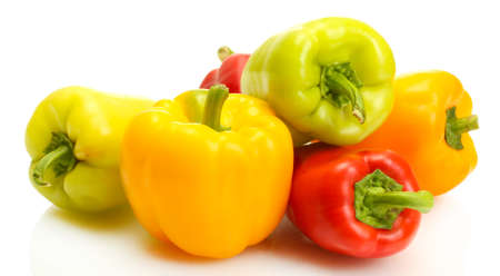 paprica: fresh yellow, red and green bell peppers isolated on white
