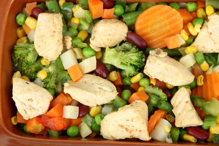 Mixed vegetables and chicken breast background photo
