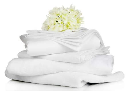 bedding: Stack of clean bedding sheets and towels isolated on white