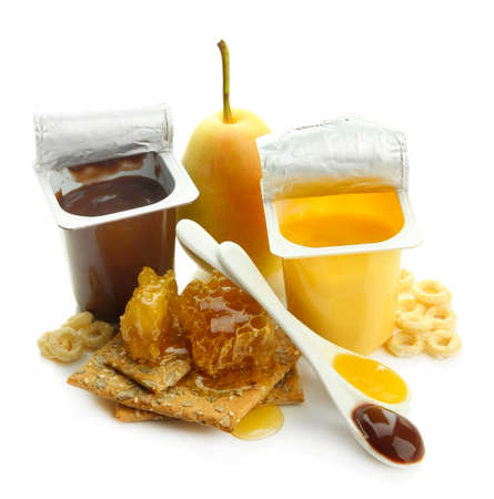 Tasty desserts in open plastic cups and honey combs, isolated on white Stock Photo - 22749850