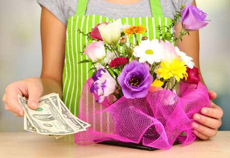 Florist makes flowers bouquet  photo