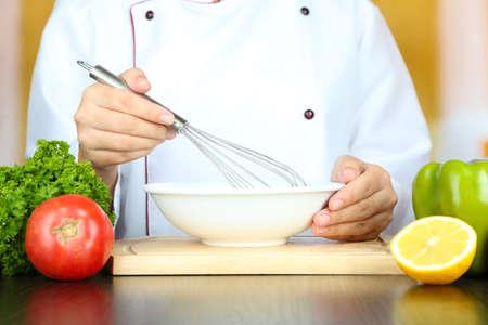 whisking: Cook hands whisking mayonnaise