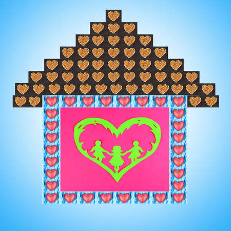 Collage of house made of heart-shaped things on blue background photo