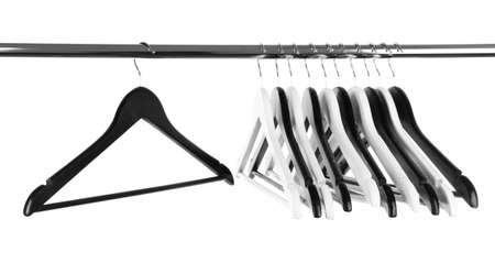 Black and white clothes hangers isolated on white photo