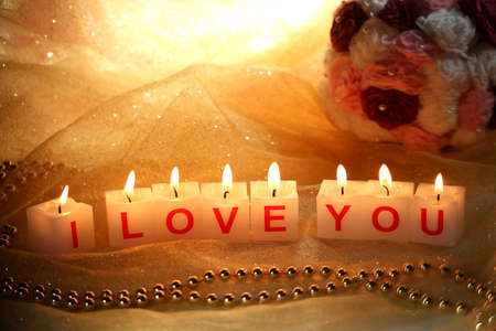 Candles with printed sign I LOVE YOU,on  dark background photo
