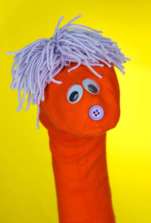 sock puppet: Cute sock puppet on yellow background