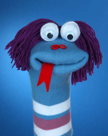 sock puppet: Cute sock puppet on blue background Stock Photo