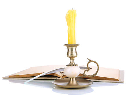 candleholder: Old candleholder with candle isolated on white