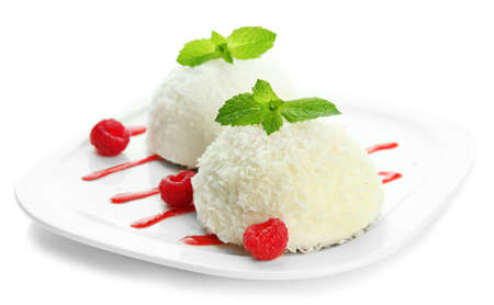 Delicious coconut cakes isolated on white photo
