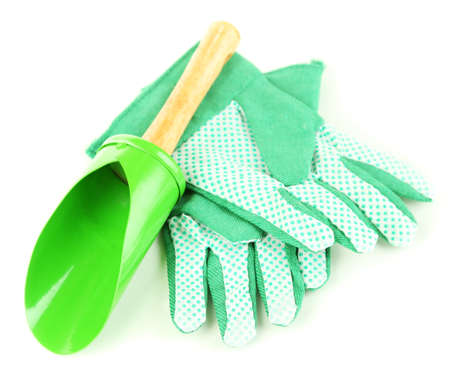 Small gardening shovel and gloves isolated on white photo