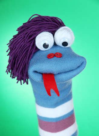 sock puppet: Cute sock puppet on green background