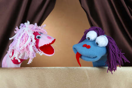 Puppet show on brown background photo