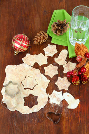 Making Christmas cookies on wooden table photo