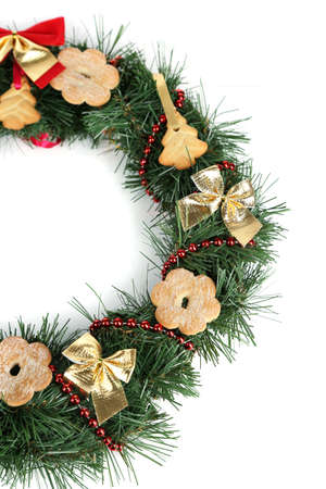 Christmas wreath decorated with cookies isolated on white photo