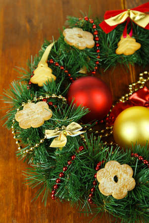 Christmas wreath decorated with cookies on wooden background photo