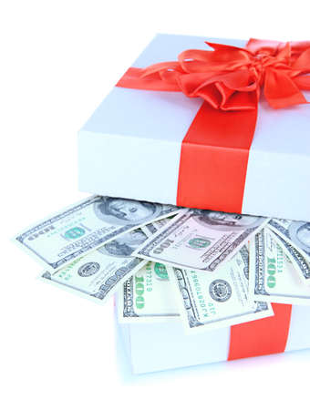 Dollars in gift box isolated on white photo