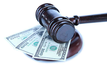 unfairness: Gavel and money isolated on white
