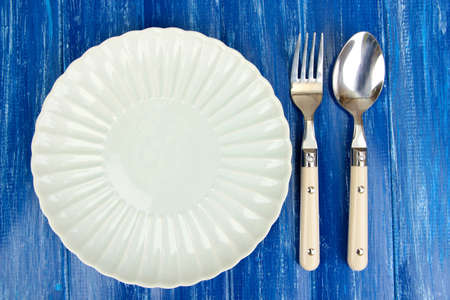 Plate and cutlery on wooden table close-up Stock Photo - 22968385