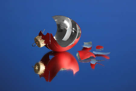 Broken Christmas Toy on blue background Stock Photo - 22949179