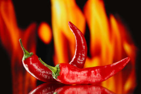 Red hot chili peppers on fire background photo