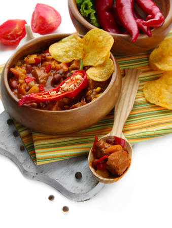 Chili Corn Carne - traditional mexican food, in wooden bowl, on napkin, isolated on white photo