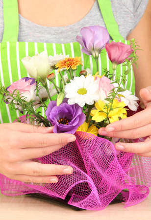 Florist makes flowers bouquet  photo