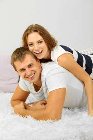 Happy young couple at home photo