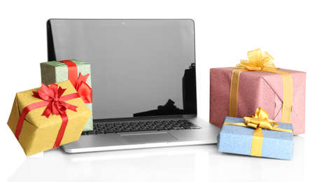 Laptop and gifts isolated on white photo