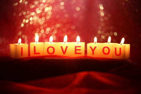 Candles with printed sign I LOVE YOU,on  bright background photo