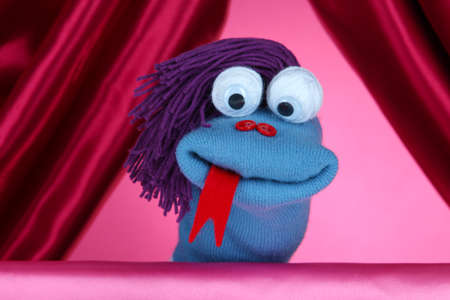 Puppet show on pink background photo