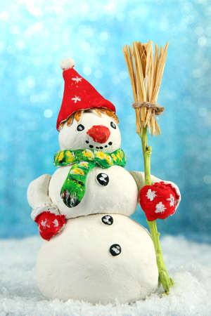 Beautiful snowman and, on bright background photo
