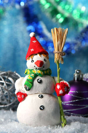 Beautiful snowman and Christmas decor, on bright background photo