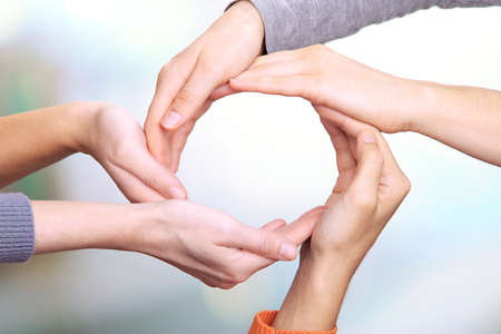 building trust: Human hands making circle on bright background