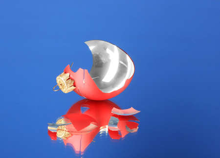 Broken Christmas Toy on blue background photo