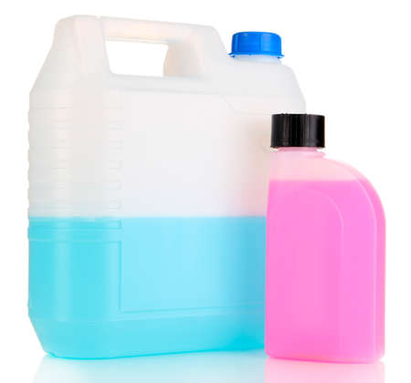 Blue and pink liquids for car in canisters isolated on white photo