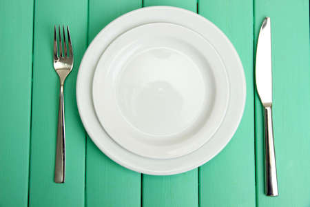 Plate and cutlery on wooden table close-up Stock Photo - 23234567