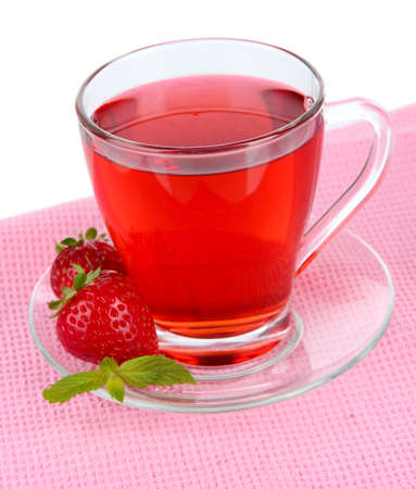 Delicious strawberry tea on table on white background photo