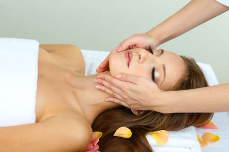 Beautiful young woman during facial massage in cosmetic salon close up Stock Photo - 24172897
