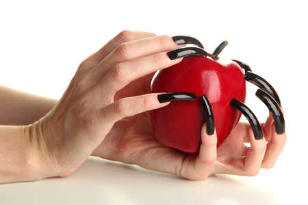 Hands with scary manicure holding red apple , isolated on white photo