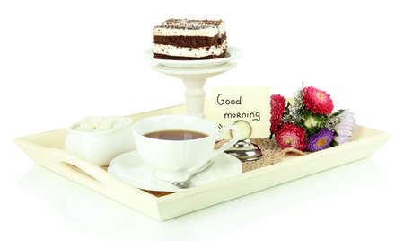good color: Cup of tea with cakes on wooden tray isolated on white