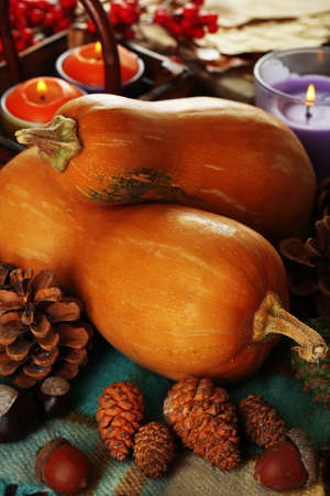 Composition for Halloween with pumpkins on fabric  photo