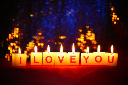 Candles with printed sign I LOVE YOU,on  blur lights  photo