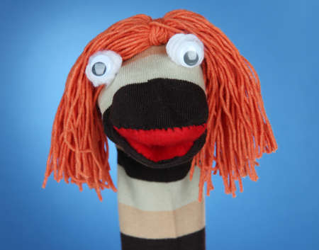 sock puppet: Cute sock puppet on blue