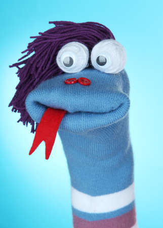 Cute sock puppet on blue  photo