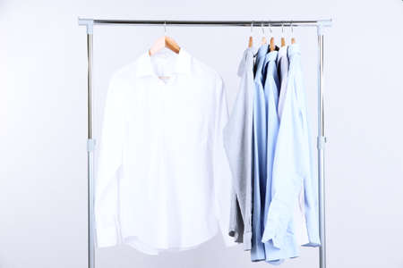 Office male clothes on hangers, on gray  photo